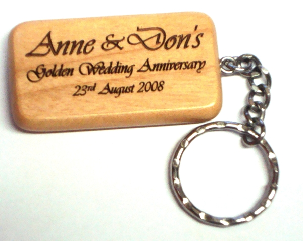 Rectangular maple keyring.